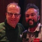 DanceSafe Executive Director, Mitchell Gomez (right), pictured with Colorado Governor Jared Polis.